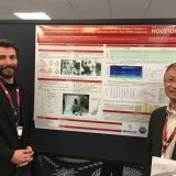 Musa Ozturk, a UH graduate student, stands in front of the award-winning poster with Jianping Wu, senior principal scientist at Medtronic and co-author of the study.